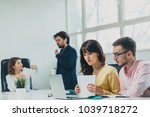 colleagues working at office in ... | Shutterstock . vector #1039718272