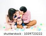 happy family   adorable asian... | Shutterstock . vector #1039723222
