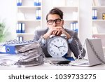 busy employee chained to his... | Shutterstock . vector #1039733275