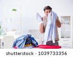 Small photo of Inattentive husband burning clothing while ironing