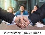 business shaking hands of... | Shutterstock . vector #1039740655