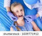 little girl sitting in the...   Shutterstock . vector #1039771912