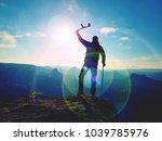 be winner. man tourist after...   Shutterstock . vector #1039785976