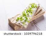 rye crispbread with soft cheese ... | Shutterstock . vector #1039796218
