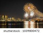 fireworks in boston harbor in... | Shutterstock . vector #1039800472