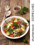 salad with egg  bean and potato   Shutterstock . vector #1039811482