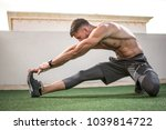 muscular sportsman warming up... | Shutterstock . vector #1039814722