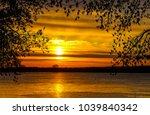 sunset nature river sky through ... | Shutterstock . vector #1039840342