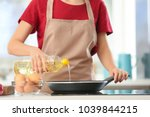 woman pouring cooking oil from... | Shutterstock . vector #1039844215