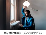 hitting a fly with flyswatter.... | Shutterstock . vector #1039844482