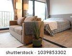 studio bedroom with living area ... | Shutterstock . vector #1039853302