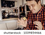 a man eagerly holds a gold coin ... | Shutterstock . vector #1039854466