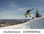 snowboarder female jumping on... | Shutterstock . vector #1039858966