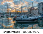 The yacht harbor and marina in the city center of Ostend at sunset with a lovely reflection of nautical vessels, West Flanders, Belgium.
