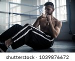 man boxer training hard for a... | Shutterstock . vector #1039876672