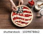 woman preparing american flag...   Shutterstock . vector #1039878862