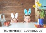 having fun on easter egg hunt.... | Shutterstock . vector #1039882708