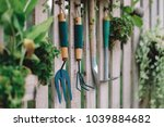gardening equipment hanging on... | Shutterstock . vector #1039884682