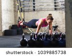 fitness woman doing push ups in ... | Shutterstock . vector #1039885738