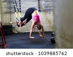 fitness woman doing push ups in ... | Shutterstock . vector #1039885762
