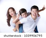 happy asian family with white t ... | Shutterstock . vector #1039906795