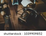 black vintage telephone on... | Shutterstock . vector #1039909852