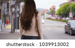latina woman standing on busy... | Shutterstock . vector #1039913002