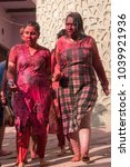 Small photo of Barsana, India - February 25, 2018: People celebrating the festival of colours called Holi. It is one of the prominent Hindu festival and is celebrated with great enthusiasm across the country.