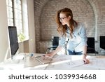 beautiful woman working in... | Shutterstock . vector #1039934668