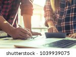 casual business team writing... | Shutterstock . vector #1039939075