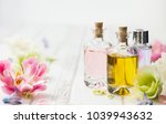 bottles with essential aroma... | Shutterstock . vector #1039943632