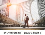 businessman looking at central... | Shutterstock . vector #1039955056
