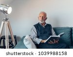 elderly man reading a book on...   Shutterstock . vector #1039988158