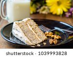 slice of walnut banana cake... | Shutterstock . vector #1039993828
