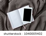tablet on pink notebook and... | Shutterstock . vector #1040005402