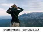 young woman photographer...   Shutterstock . vector #1040021665