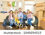 family showing thumbs up  boxes....   Shutterstock . vector #1040054515
