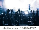 crowd at concert   summer music ... | Shutterstock . vector #1040061922