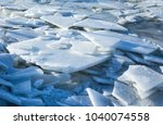 the layers of ice float along...   Shutterstock . vector #1040074558
