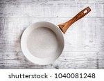 white frying pan on white...   Shutterstock . vector #1040081248