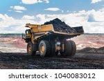 big dump truck or mining truck... | Shutterstock . vector #1040083012
