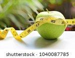 green apple bind with tape...   Shutterstock . vector #1040087785