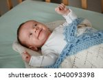 little baby laying on a bed   Shutterstock . vector #1040093398