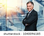 smiling businessman in his... | Shutterstock . vector #1040096185
