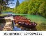 Row of wooden rowboats waiting...