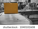 color cardboard box moves on... | Shutterstock . vector #1040102608