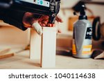 man builds furniture in the... | Shutterstock . vector #1040114638