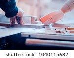 a carpenter works on... | Shutterstock . vector #1040115682