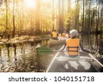 Canoeing down beautiful river in a Cypress Forest