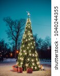 a christmas tree and golden... | Shutterstock . vector #1040244355